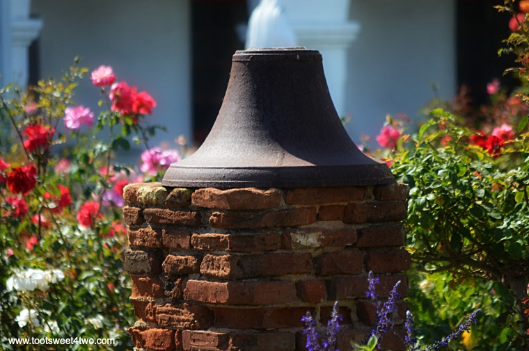 Mission Bell on brick column at Mission San Luis Rey