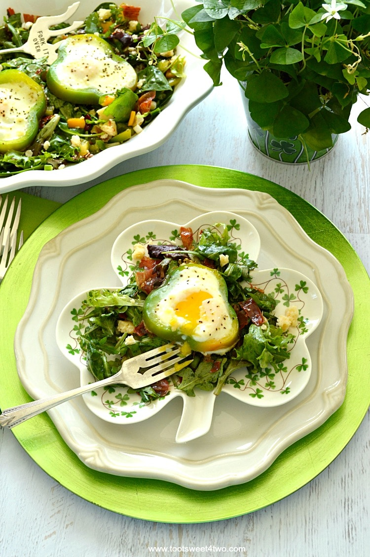 Shamrock Poached Eggs on Field Greens - a delicious and easy breakfast or brunch recipe. A perfect poached egg nestled on a bed of spicy arugula salad dressed with surprise ingredients. What's not to love? | www.tootsweet4two.com