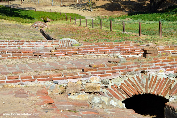 Irrigation channels winding through landscape at Mission San Luis Rey Lavanderia