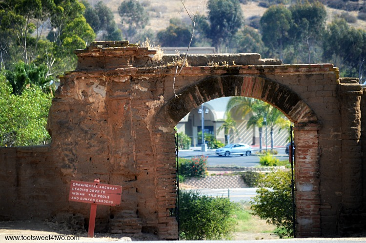 Lavanderia archway at Mission San Luis Rey overlooking a road