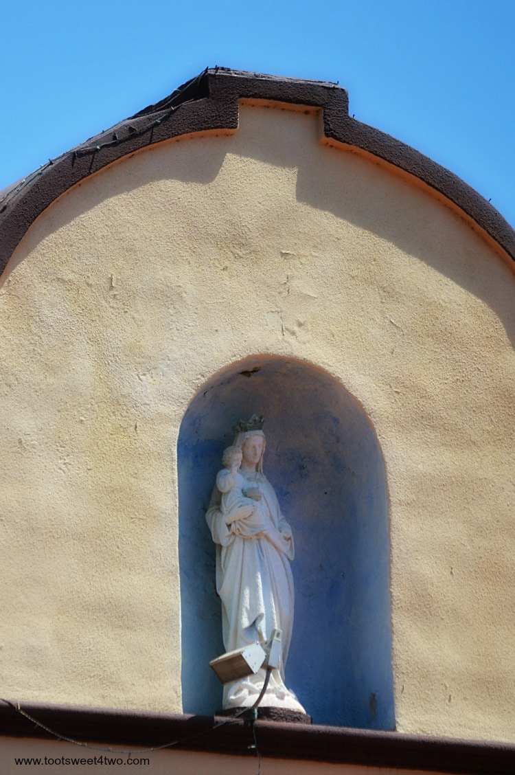 Madonna and Child sculpture in building at Old Mission San Luis Rey Gardens