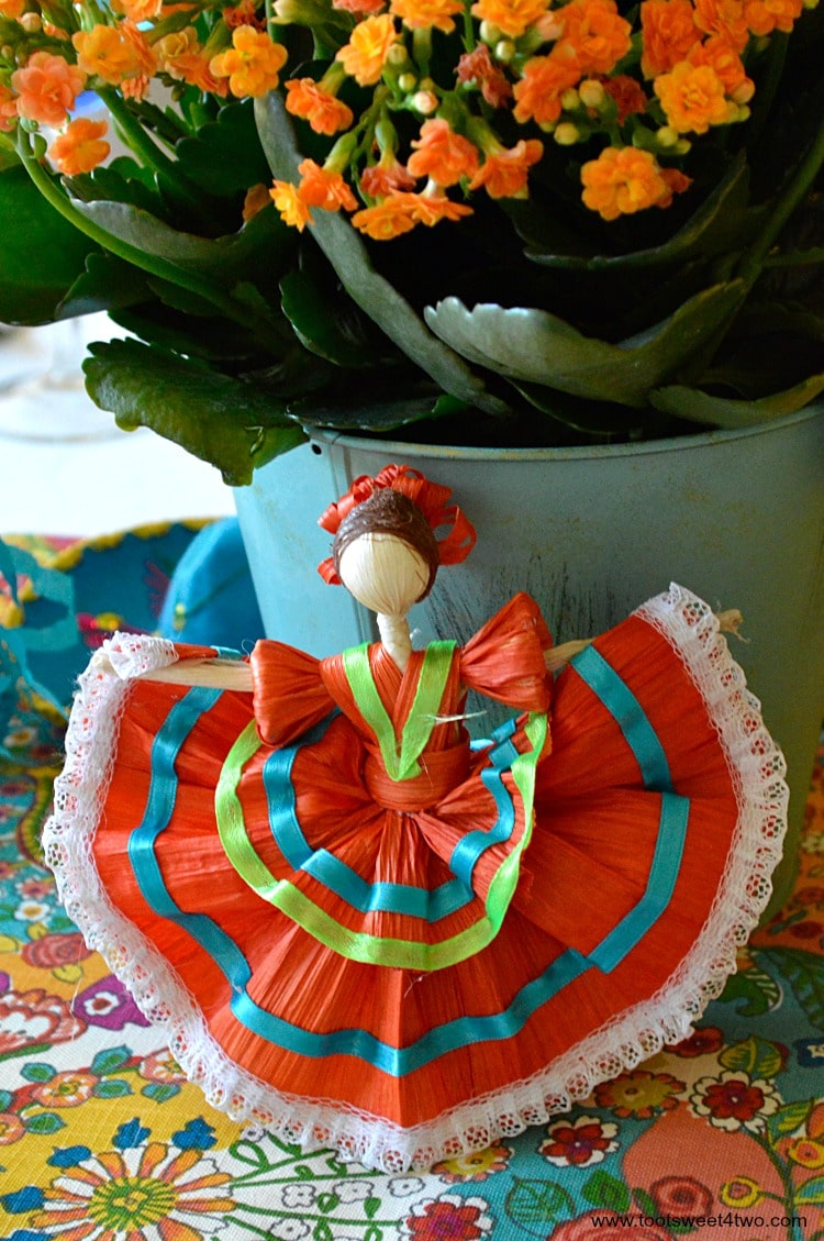 Orange corn husk doll for Decorating the Table for a Cinco de Mayo Celebration