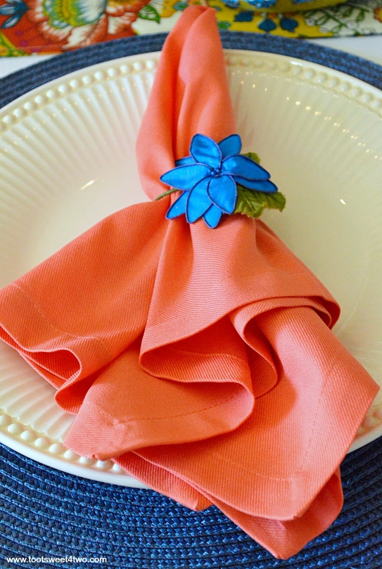 Peach napkin and blue flower napkin ring for Decorating the Table for a Cinco de Mayo Celebration