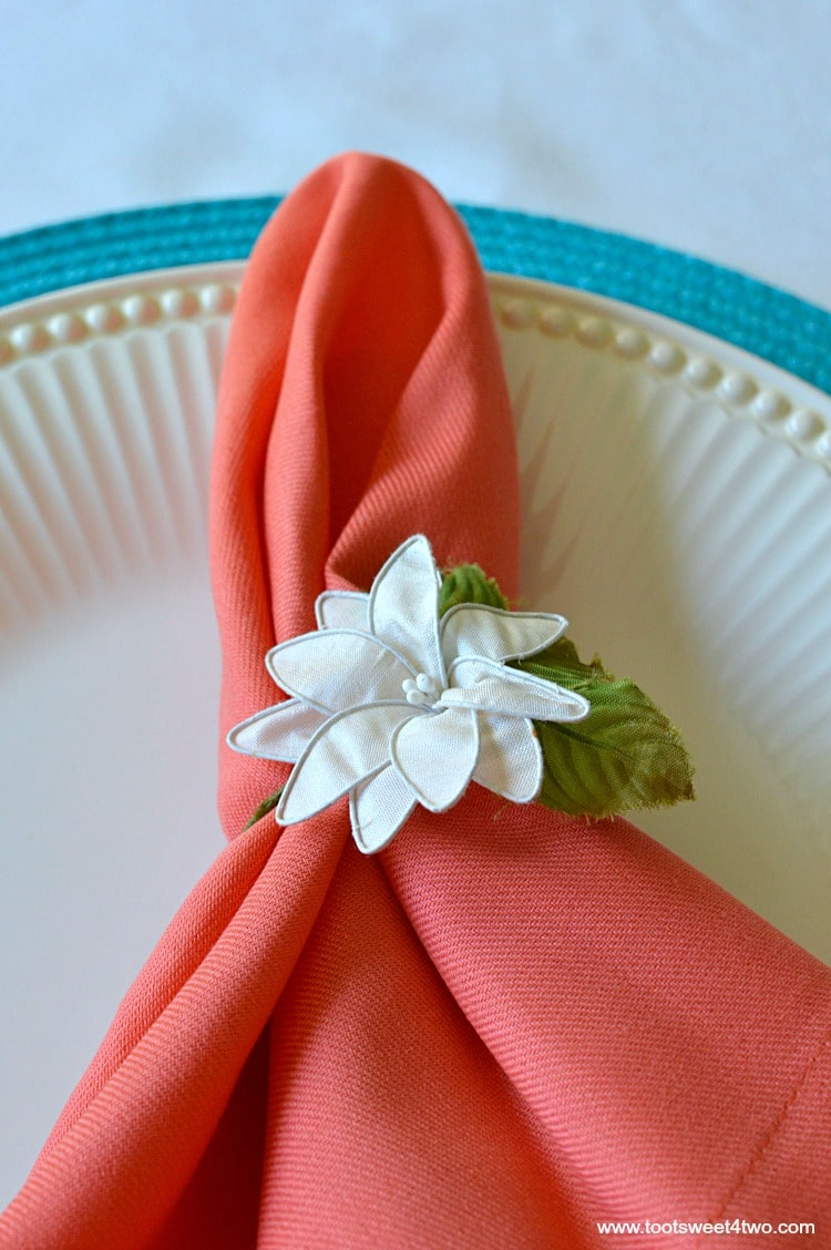 Peach napkins and blue placemat for Decorating the Table for a Cinco de Mayo Celebration