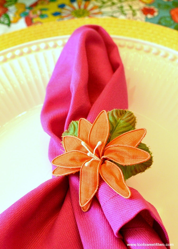 Pink napkin and orange flower napkin ring for Decorating the Table for a Cinco de Mayo Celebration