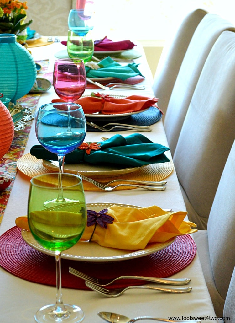 Place settings in a row for Decorating the Table for a Cinco de Mayo Celebration