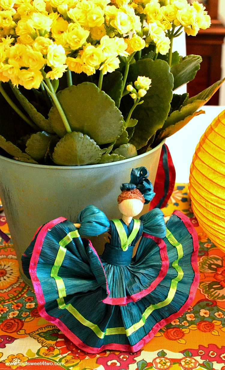 Teal corn husk doll for Decorating the Table for a Cinco de Mayo Celebration