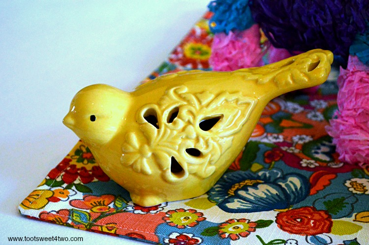 Yellow ceramic bird for Decorating the Table for a Cinco de Mayo Celebration