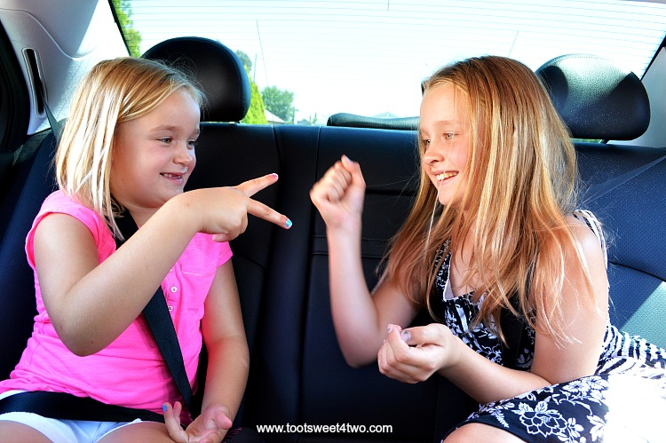 Playing Rock, Paper, Scissors in the car