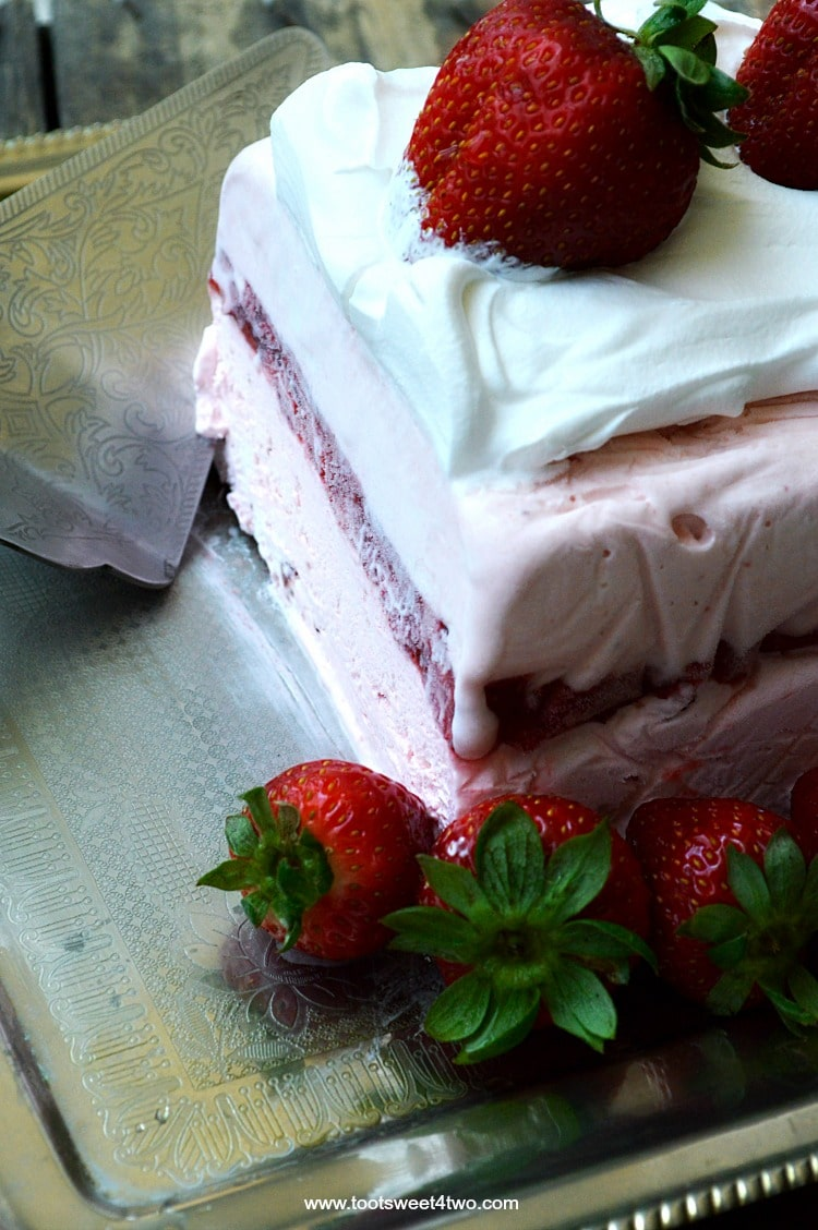 "Looking for unique cheesecake recipes? Look no further! Strawberry Icebox Cheesecake is an easy, frozen, no bake strawberry cheesecake dessert that combines an easy-to-make strawberry cheesecake layer with a layer of strawberry cheesecake ice cream. Frozen for hours or overnight, unmold this luscious concoction onto a pretty platter, dollop with Cool Whip and then top with fresh strawberries. A spectacular-looking dessert, this delicious recipe will ""wow"" friends and family. 