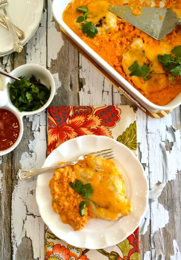 Cheesy Fiesta Salsa Chicken and Rice Bake is an easy and delicious dinner recipe for a busy night. Dump 7 simple ingredients in a casserole dish and bake! This easy prep casserole takes less than 10 minutes to assemble and dinner is served in under an hour! | www.tootsweet4two.com