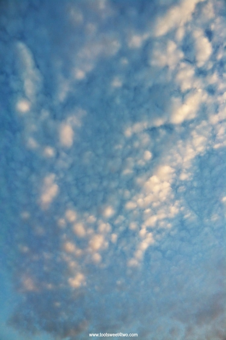 Blue cloudy sky - Both Sides of Clouds
