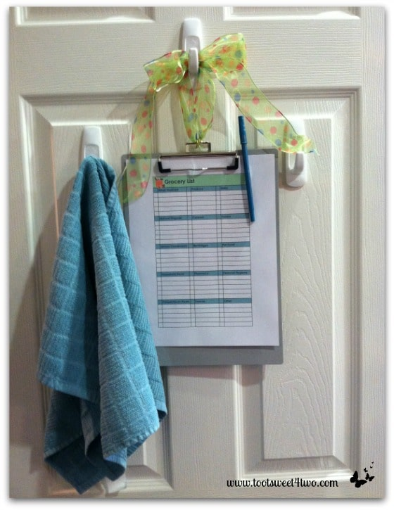 Grocery List Clipboard hanging in pantry