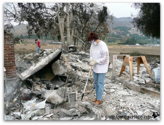 Debra looking at a shard of ceramic rubble