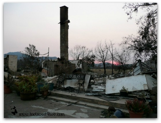 Sunset over burned out house