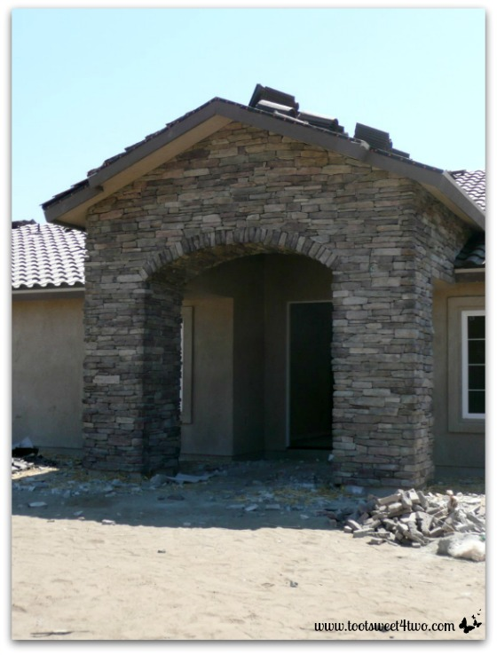 Completed stone work on front entrance.