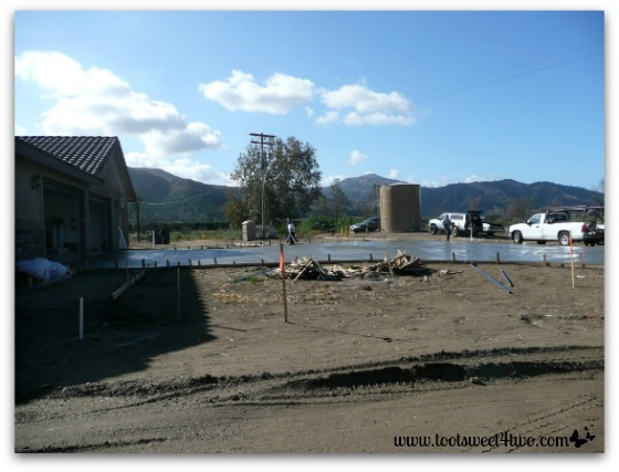 Concrete driveway poured and 10,000 gallon water tank