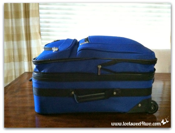 Emergency clothes packed in suitcase