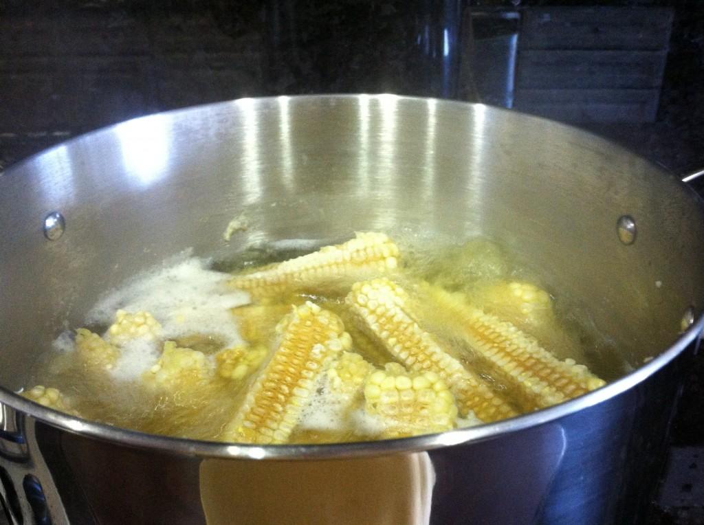Boiling corn cobs