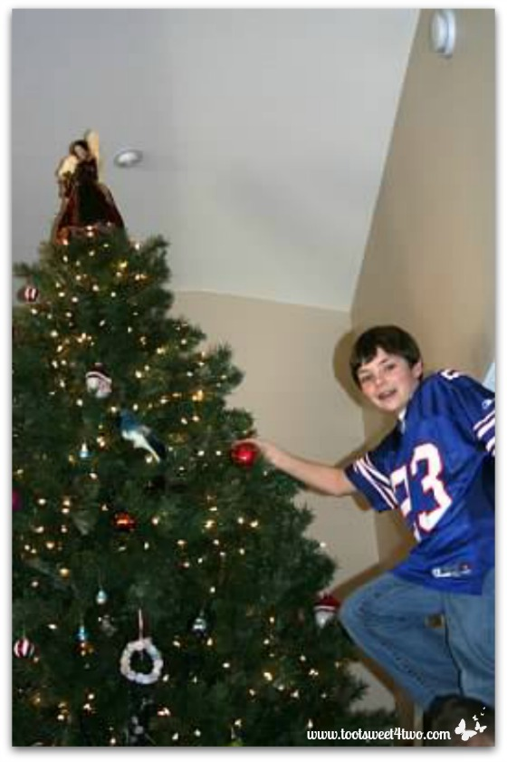 Ryan on the 12 foot ladder putting ornaments on the Christmas tree