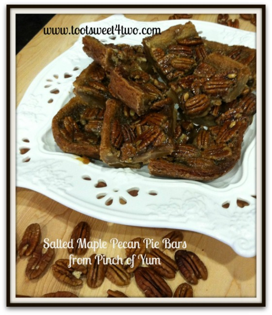 A plate full of Salted Maple Pecan Pie Bars