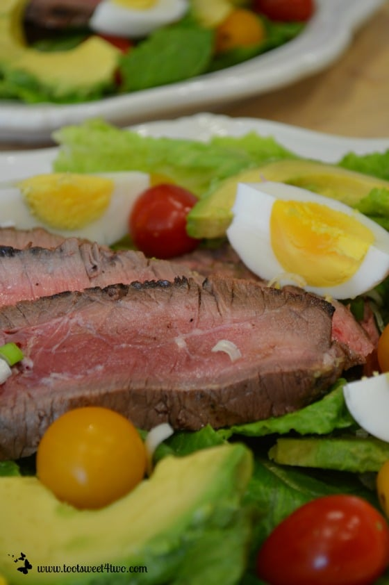 Adding veggies to salad