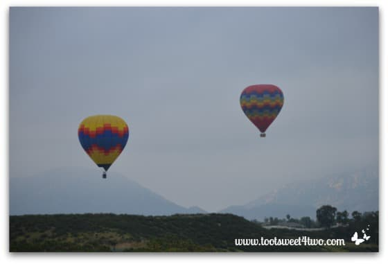 Close-up of 2 Hot Air Balloons ascending