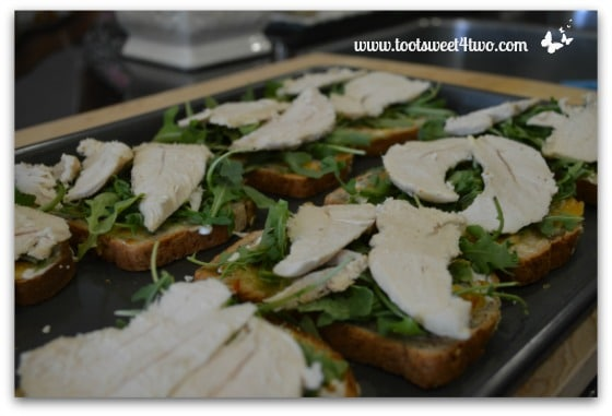 Chicken breast tenders on Chicken and Arugula Open-faced Sandwiches