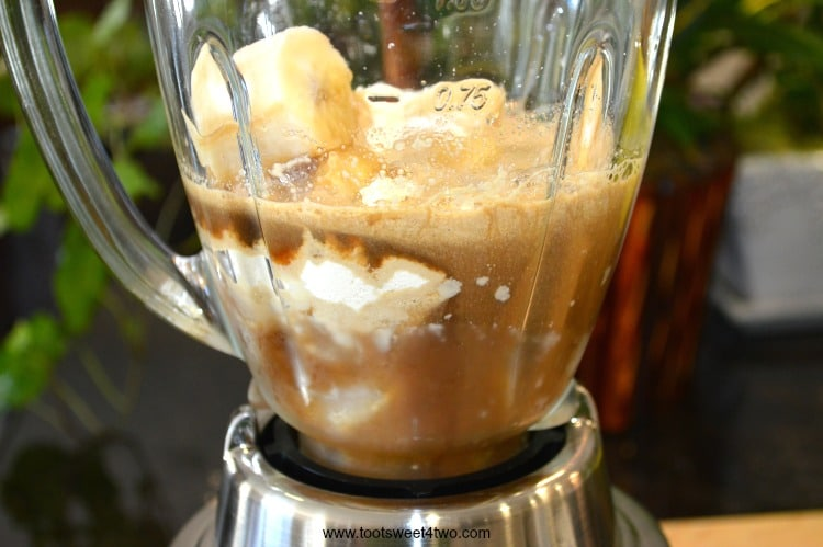 Coffee Banana Protein Smoothie in the Blender - an easy, delicious and healthy way to start your morning. Coffee and whey protein powder supply the energy and a serving of fruit, a frozen banana, makes it the perfect blender breakfast. Whether you are watching calories for weight loss or just need a quick breakfast with extra protein, this recipe delivers. | www.tootsweet4two.com
