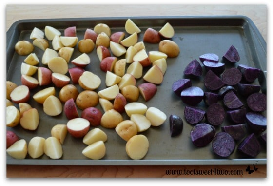 Quartered and halved potatoes for Tri-Colored Roasted Potato Salad