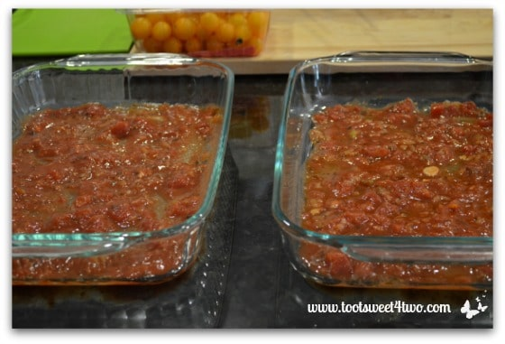 Pour salsa in baking pans - Charlie's Lite Layered Mexican Casserole