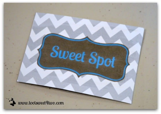 Use Mod Podge to glue signs to cardstock