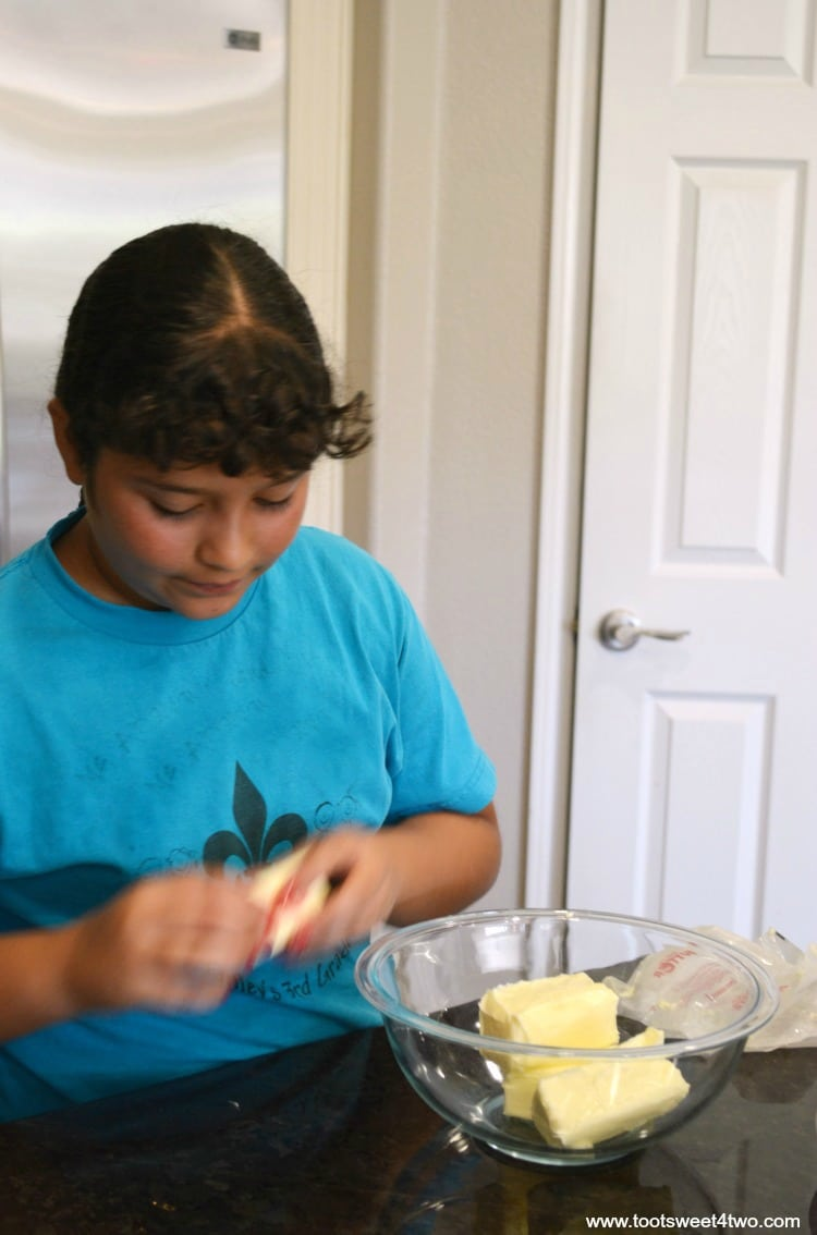 Princess J.O. opening the butter