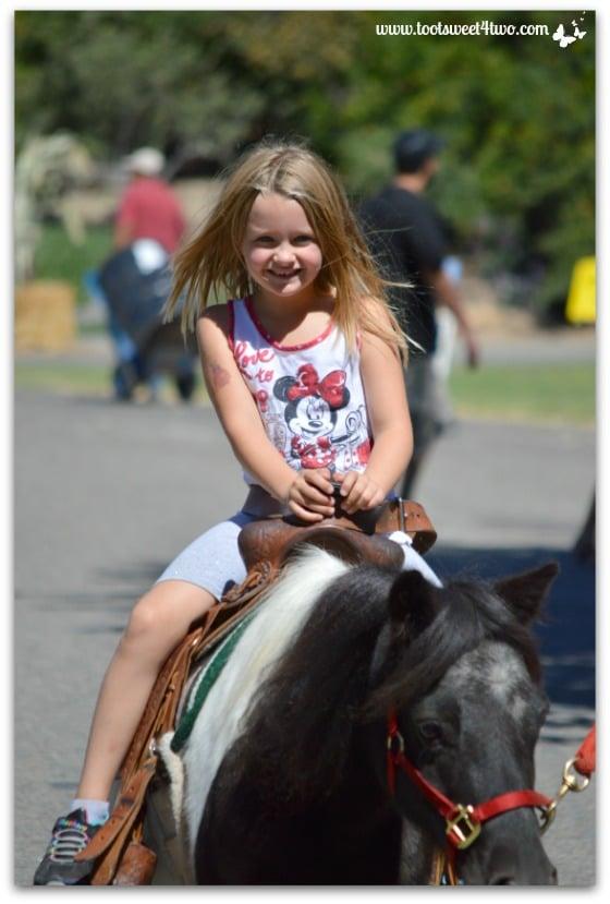 Princess Sweetie Pie all smiles on her pony