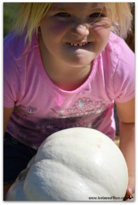 Princess Sweetie Pie hoists a pumpkin