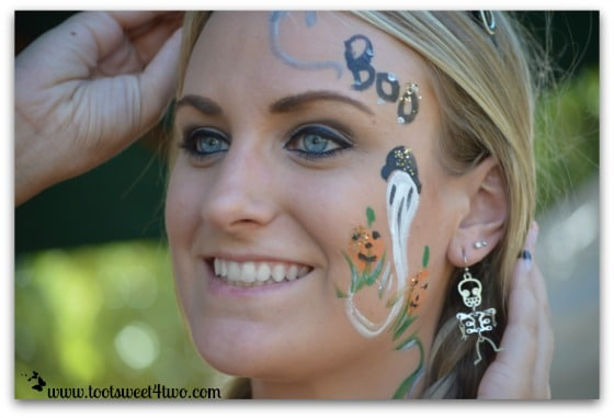 Samantha's face-painting and her skeleton earrings