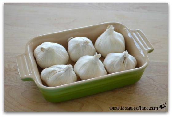 6 garlic bulbs in baking dish