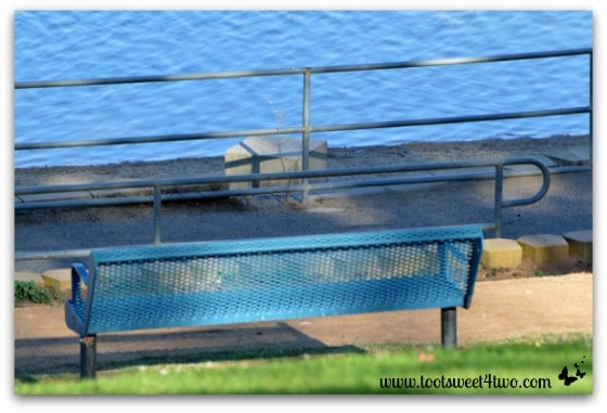 Park bench beside the water at Lake Poway