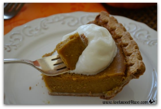 Pumpkin Pie and whipped cream on a fork