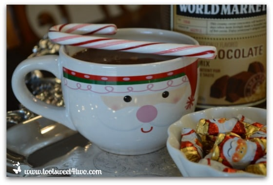 Candy cane on hot chocolate mug