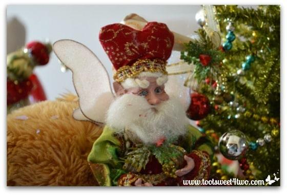 Christmas Fairy next to a Christmas tree