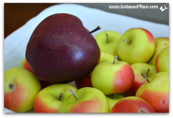 Red Delicious apple in a bowl with Lady Apples