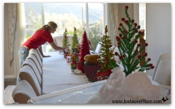 Samantha setting this year's Christmas table