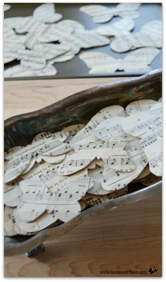 Crafting butterflies from sheet music - vertical
