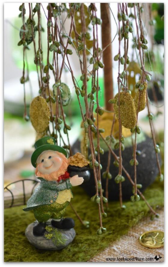 Eamon, Protector of Prosperity leprechaun under his pot of gold tree