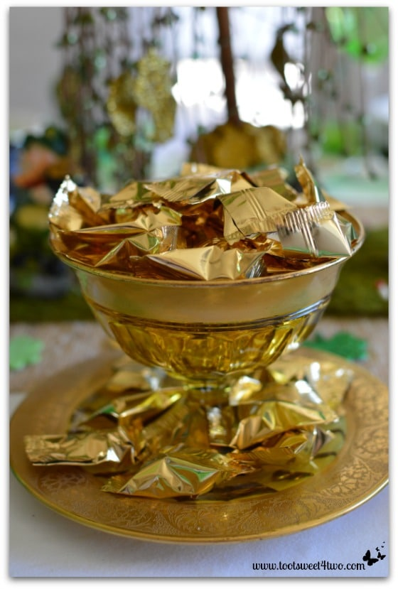 Gold buttermints in a gold bowl