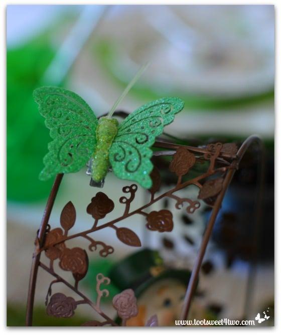 Green glitter butterfly over leprechaun