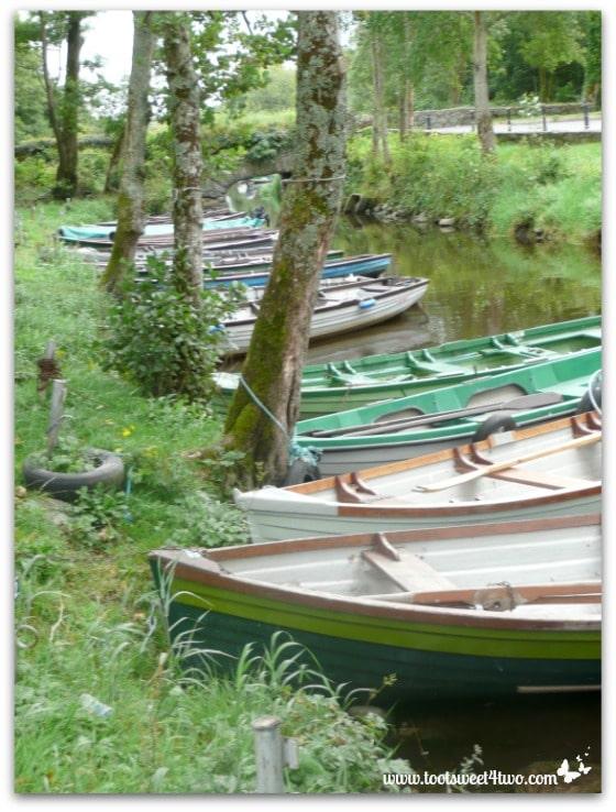 Green rowboats in Killarney National Park, Ireland