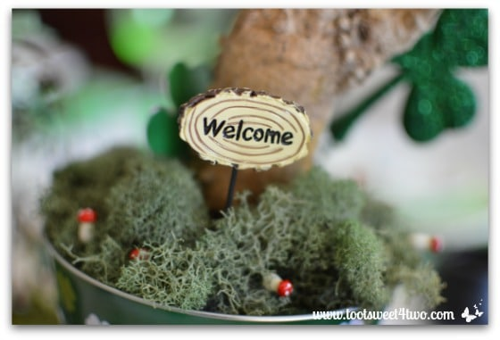 Welcome fairy sign and mini mushrooms with moss