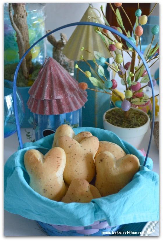 Buttery Springtime Poppy Seed Dinner Rolls in an Easter basket